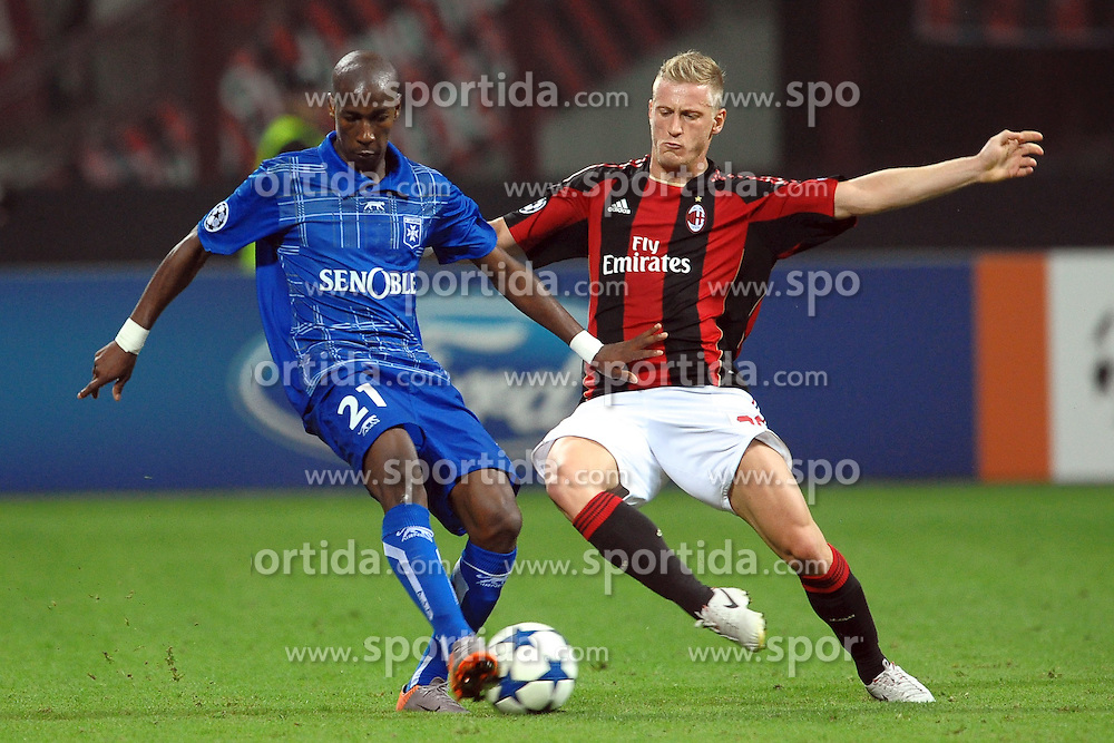 15.09.2010, Stadio Giuseppe Meazza, Mailand, ITA, UEFA CL, AC Milan vs Auxerre, im Bild Steven LANGIL Auxerre, Ignazio ABATE Milan.EXPA Pictures © 2010, PhotoCredit: EXPA/ InsideFoto/ Andrea Staccioli +++++ ATTENTION - FOR AUSTRIA AND SLOVENIA CLIENT ONLY +++++... / SPORTIDA PHOTO AGENCY