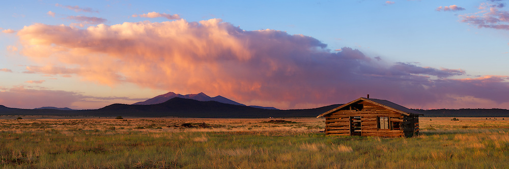 An abandoned cabin in the Garland Prairie area of northern Arizona. In the distance are the San Francisco Peaks near Flagstaff.