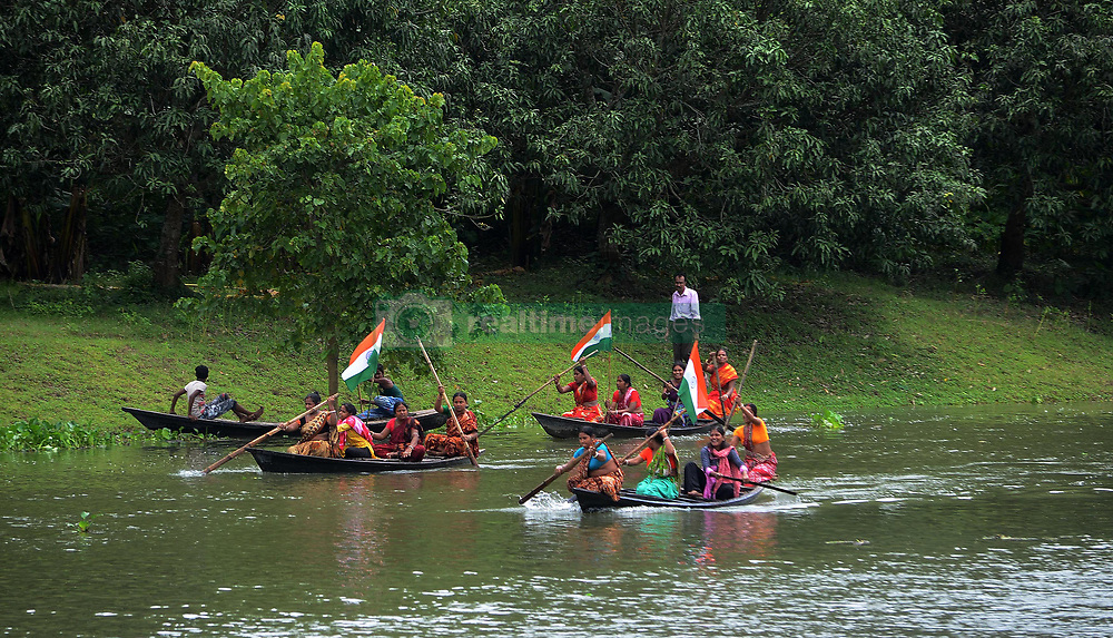 August 18, 2017 - Shivnibas, Nadia, India - Indian women participates in Boat Race on Churni River on the occasion of Independence Day celebration in Shivnibas, Nadia district , 95 km from Kolkata , India on Friday , 18th August, 2017. While the entire nation celebrated Independence Day on August 15, one part of India observed the national event on 18th August . It might sound strange to many but the reason behind this delayed celebration is because of a cartographic error made by Sir Cyril Radcliffe 70 years ago. On August 12, 1947 news on radio stated that India had been granted freedom but unfortunately a part of Nadia district had been awarded to East Pakistan. Pre-independent Nadia had five subdivisions: Krishnagar Sadar, Meherpur, Kusthia, Chuadanga and Ranaghat and all these areas except Nabadwip were given to East Pakistan. Celebration followed the next day and the Pakistani flag, which was raised by Muslim league in the Krishnanagar (Dist. headquarters of Nadia) was brought down and replaced with the Indian tricolour on 18 August. (Credit Image: © Sonali Pal Chaudhury/NurPhoto via ZUMA Press)