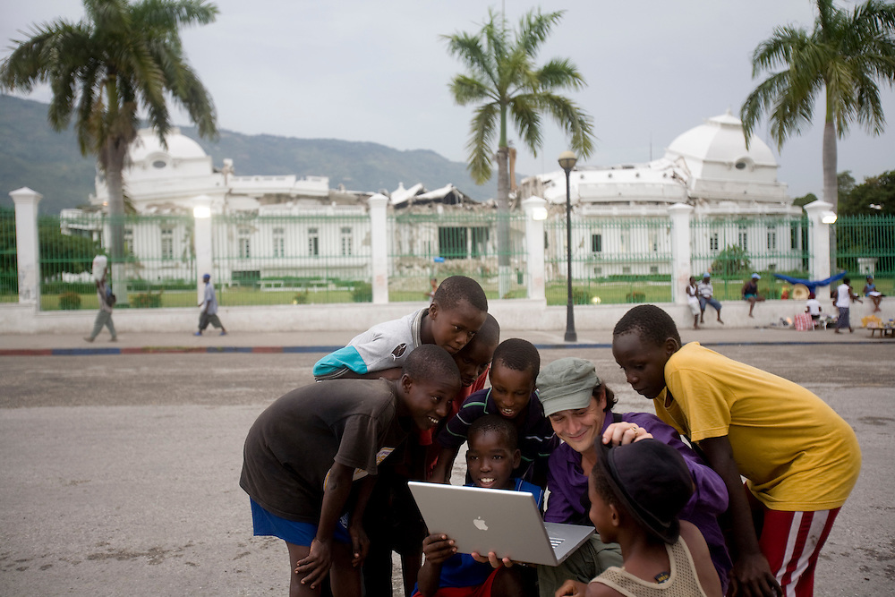 David Koubbi, in front of the National Palace, shows kids pictures he took the day before in the camp where they live. Koubbi, a French lawyer, is visiting Haiti to advocate to the Haitian government for passports for 56 children. The children were in the adoption process before the earthquake and though the adoptions have all been finalized, the children need passports before they can join their adopted families in France.