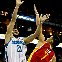 Jan 9, 2013; New Orleans, LA, USA; New Orleans Hornets point guard Greivis Vasquez (21) shoots over Houston Rockets point guard Jeremy Lin (7) during the second quarter of a game at the New Orleans Arena. Mandatory Credit: Derick E. Hingle-USA TODAY Sports