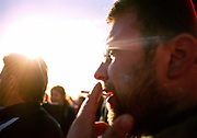 A man smoking a spliff in the sun, Glastonbury, 2004<br /> MODEL RELEASED