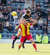 12th May 2018, Dens Park, Dundee, Scotland; Scottish Premier League football, Dundee versus Partick Thistle; Dan Jefferies of Dundee heads clear from Kris Doolan of Partick Thistle