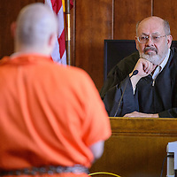 030514       Cable Hoover<br /> <br /> District court judge Grant Foutz listens to Natanael Escacega's guilty plea Wednesday at district court in Gallup.