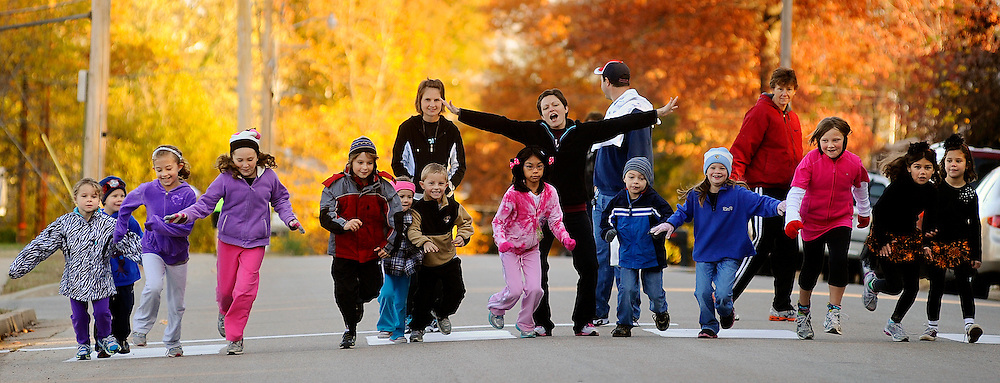 """A group of children take off on the word """"Go!"""" at the start of the Kids Fun Run portion of the Bulldog Breezer 5k Run/Walk at Belair Elementary School in Jefferson City, Mo."""