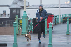 Brighton, UK. 20/11/2016, A man braves the wind and rain to go running on the promenade while Brighton is being hit with the remnants of storm Angus who has his the seaside resort overnight with strong waves and powerful 80mph winds. Photo Credit: Hugo Michiels