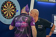 WINNER Peter Wright (Scotland) and Referee Russ take a closer look at the winning dart after the final of the PDC William Hill World Darts Championship at Alexandra Palace, London, United Kingdom on 1 January 2020.