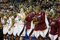 The S. Illinois bench cheers on their team during action against Holy Cross.  The #4 seed Southern Illinois Salukis defeated the #13 seed Holy Cross Crusaders 61-51  in the first round of the Men's NCAA Tournament in Columbus, OH on March 16, 2007.