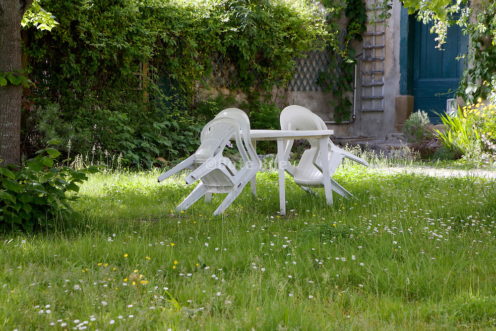garden chairs in garden spring time
