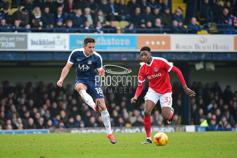 Southend United defender Ryan Leonard (18) clears from Charlton Athletic defender Joe Aribo (32) during the EFL Sky Bet League 1 match between Southend United and Charlton Athletic at Roots Hall, Southend, England on 31 December 2016. Photo by Jon Bromley.