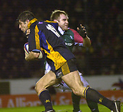© Peter Spurrier/Intersport Images .Tel + 441494783165 email images@Intersport-images.com.27/12/2003 - Photo  Peter Spurrier.2003/04 Zurich Rugby Premiership Leicester v Leeds.Leeds's lat sub Dan Hyde is tackled by Tigers's Andy Goode