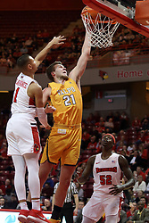 27 January 2018:  Derrik Smits lays up the ball passing blocker Elijah Clarance during a College mens basketball game between the Valparaiso Crusaders and Illinois State Redbirds in Redbird Arena, Normal IL