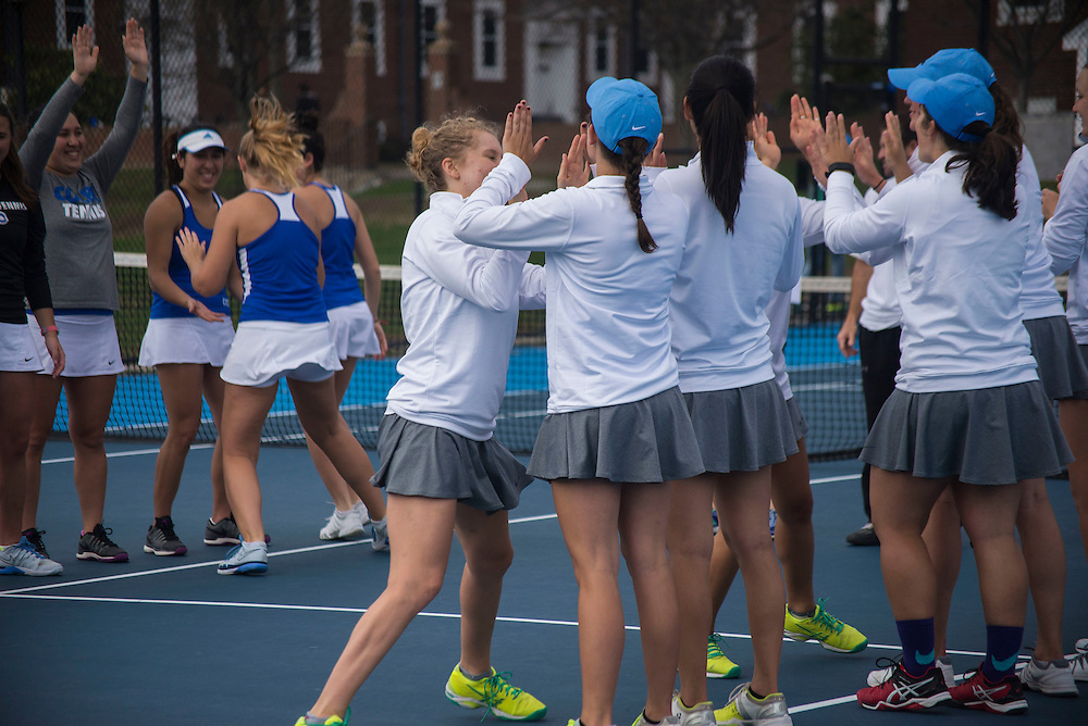 4/1/16 - Medford/Somerville, MA - Hannah Conroy gives high-fives to her teammates during the Tufts women's tennis matches against Colby on the Voute Tennis Courts on Apr 1, 2016. (Ray Bernoff / The Tufts Daily)