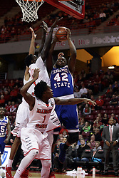 "22 December 2015: Daouda ""David"" Ndiaye (4) tries to stop a shot by Christian Griggs-Williams(42). Illinois State Redbirds host the Tennessee State Tigers at Redbird Arena in Normal Illinois (Photo by Alan Look)"
