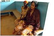 Bea Ahbeck/Fremont Argus 10/26/05<br /> <br />  Susan Izimba, 30, (right) waits with her olders sister Mirabu Kasuswa, at Mulago Hospital in Kamuli Wednesday morning, Oct. 26, 2005. Susan is developing TB, her chest is swollen and she is coughing, and she is very week, all complications of AIDS.