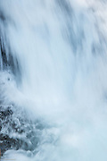 Water bounces high at the base of Madcap Falls on the Paradise River in Mt Rainier National Park.