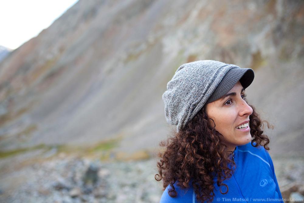 Latina woman hiking in the alpine in the colorado rockies.