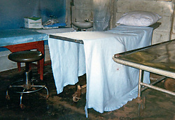 17th November, 2005. Mandeville, Louisiana. <br /> Photo courtesy Denise Leblanc 2000. The mud floored, extremely basic medical facilities of a prison island colony 'hospital' in Panama 'She was treated by 'El Doctor,' a prison medic at the remote prison island colony off the Panamanian coast where Denise was taken for immediate medical attention. Denise was speared by a Blue Marlin in a freak fishing accident. Denise and her doctors have credited her breast implant with saving her life. <br /> Photo; Charlie Varley<br /> varleypix.com<br /> Photo courtesy; Denise Le Blanc