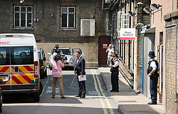 © London News Pictures. 22/07/2013. Police guard the Mary Stanford entrance to St Mary's Hospital in West London where The Duchess of Cambridge entered the hospital this morning while in labour. Photo credit: Ben Cawthra/LNP