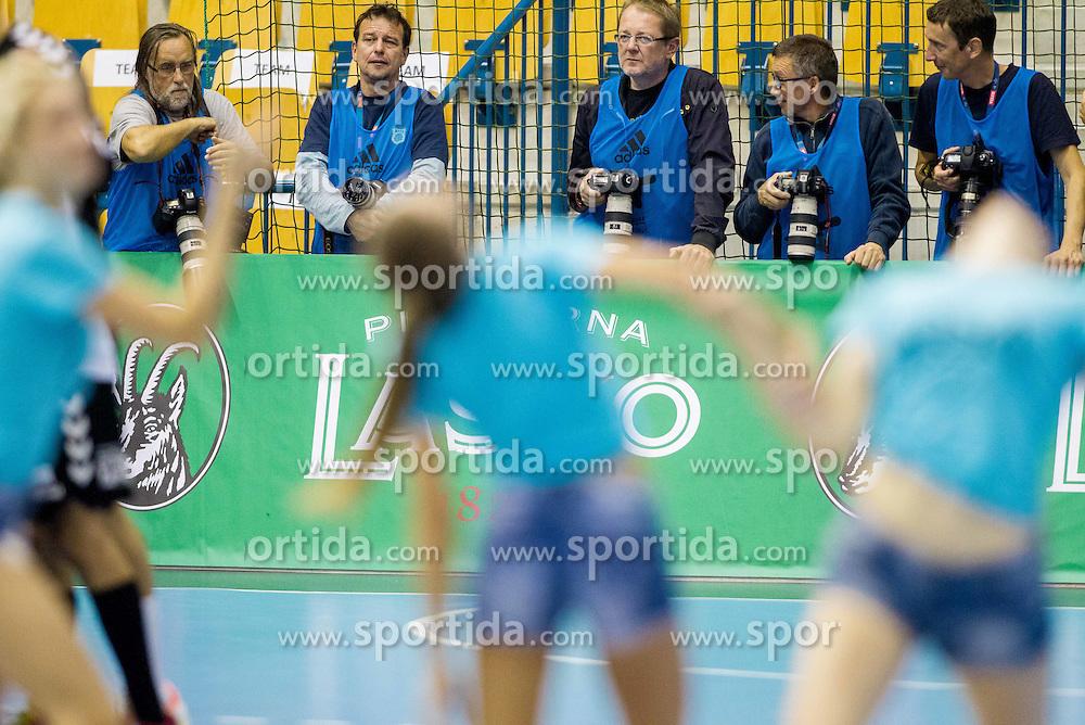 Photographers during handball match between RK Celje Pivovarna Lasko and HC Vardar Skopje (MKD) in 1st Round of Group C of EHF Champions League 2014/15, on September 27, 2014 in Arena Zlatorog, Celje, Slovenia. Photo by Vid Ponikvar / Sportida.com
