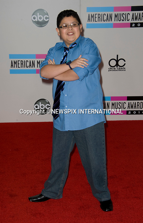 "RICO RODRIGUEZ.American Music Awards 2010,Nokia Rheatre, Los Angeles_21/10/2010.Mandatory Photo Credit: ©Dias/Newspix International..**ALL FEES PAYABLE TO: ""NEWSPIX INTERNATIONAL""**..PHOTO CREDIT MANDATORY!!: NEWSPIX INTERNATIONAL(Failure to credit will incur a surcharge of 100% of reproduction fees)..IMMEDIATE CONFIRMATION OF USAGE REQUIRED:.Newspix International, 31 Chinnery Hill, Bishop's Stortford, ENGLAND CM23 3PS.Tel:+441279 324672  ; Fax: +441279656877.Mobile:  0777568 1153.e-mail: info@newspixinternational.co.uk"