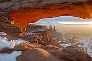 Sunrise illuminates the underside of Mesa Arch, Canyonlands National Park, Utah.