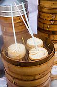 Soup dumplings with straws for sale in the Yu Garden Bazaar Market, Shanghai, China