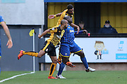 Bayo Akinfenwa of AFC Wimbledon is sandwiched during the Sky Bet League 2 match between Cambridge United and AFC Wimbledon at the R Costings Abbey Stadium, Cambridge, England on 2 January 2016. Photo by Stuart Butcher.