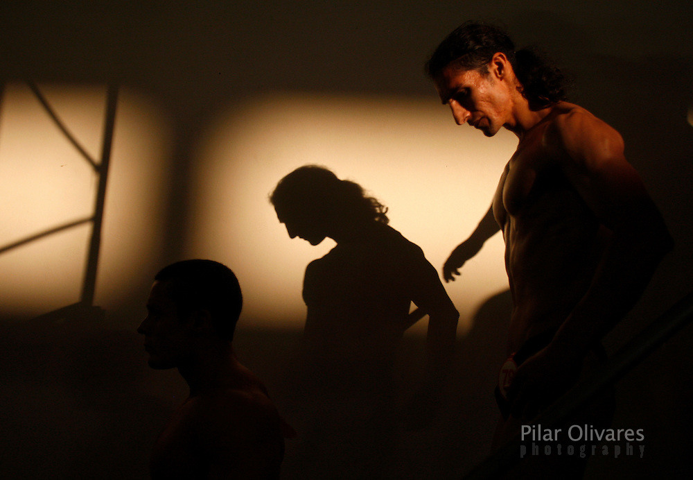 Competitors walk after their participation in a bodybuilding competition in Lima January 30, 2010.