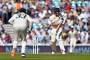 Joe Denly of England is tested by a delivery from Pat Cummins of Australia during the 5th International Test Match 2019 match between England and Australia at the Oval, London, United Kingdom on 14 September 2019.