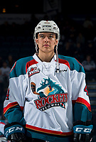 KELOWNA, CANADA - MARCH 13:  Devin Steffler #4 of the Kelowna Rockets stands on the ice at the start of the game against the Spokane Chiefs on March 13, 2019 at Prospera Place in Kelowna, British Columbia, Canada.  (Photo by Marissa Baecker/Shoot the Breeze)