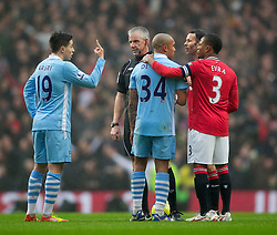MANCHESTER, ENGLAND - Sunday, January 8, 2012: Manchester City's Samir Nasri signals to referee Chris Foy against Manchester United during the FA Cup 3rd Round match at the City of Manchester Stadium. (Pic by Vegard Grott/Propaganda)