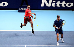 Jack Sock (left) and Mike Bryan (right) in action during their doubles match during day seven of the Nitto ATP Finals at The O2 Arena, London.