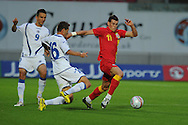 Gareth Bale of Wales goes past Senad Lulic (16). Friendly international football, Wales v Bosnia- Herzegovina  at Parc y Scarlets in Llanelli ,  South Wales on Wed 15th August 2012. pic by Andrew Orchard, Andrew Orchard sports photography,