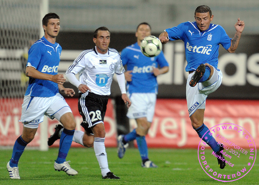 (R) JAKUB WILK (LECH POZNAN) FIGHTS FOR THE BALL DURING EXTRALEAGUE SOCCER MATCH BETWEEN LEGIA WARSAW AND LECH POZNAN DURING 8. ROUND SEASON 2009/2010...WARSAW , POLAND , SEPTEMBER 25, 2009..( PHOTO BY ADAM NURKIEWICZ / MEDIASPORT )..PICTURE ALSO AVAIBLE IN RAW OR TIFF FORMAT ON SPECIAL REQUEST.