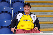 AFC Wimbledon fan smiling during the EFL Sky Bet League 1 match between AFC Wimbledon and Wycombe Wanderers at the Cherry Red Records Stadium, Kingston, England on 31 August 2019.