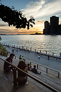 Sunset over the skyline of lower Manhattan, seen from the Granite Prospect of Brooklyn Bridge Paark.