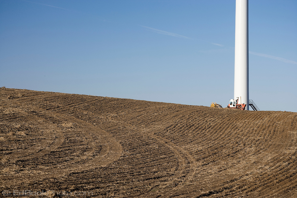 Electric generating windmill tower shares the land and air with wheat farming in the Palouse region of eastern Washington, USA