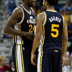 April 11, 2011; New Orleans, LA, USA; Utah Jazz power forward Paul Millsap (24) and point guard Devin Harris (5) reacts during the fourth quarter against the New Orleans Hornets at the New Orleans Arena. The Jazz defeated the Hornets 90-78.  Mandatory Credit: Derick E. Hingle