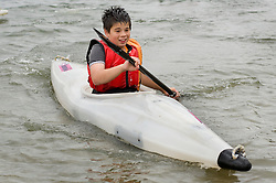 Adam Bates Guinness Northern Counties Youth Coordinator, and Phil Roache Guinnesss Northern Counties Housing Officer with Kids from the Briary Close housing scheme in Wakefield Kayaking Pugneys Country Park on Thursday  26 August 2010 .Images © Paul David Drabble..
