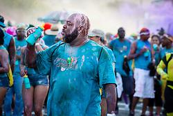 Hugo Hodge.  Carnival 2015 continues Jouvert morning on the Watefront.  St. Thomas, VI.  30 April 2015.  © Aisha-Zakiya Boyd