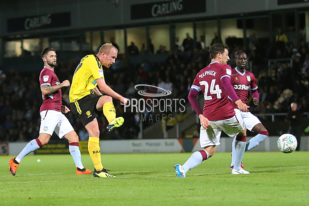 Burton Albion forward Liam Boyce (27) shoots at goal during the second round or the Carabao EFL Cup match between Burton Albion and Aston Villa at the Pirelli Stadium, Burton upon Trent, England on 28 August 2018.