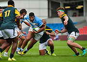 Argentina's Ruben Ricco  breaks a tackle during the World Rugby U20 Championship 3rd Place play-off  match Argentina U20 -V- South Africa U20 at The AJ Bell Stadium, Salford, Greater Manchester, England on Saturday, June 25, 2016.(Steve Flynn/Image of Sport)