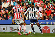 West Bromwich Albion defender Joleon Lescott takes on Stoke City defender Geoff Cameron during the Barclays Premier League match between Stoke City and West Bromwich Albion at the Britannia Stadium, Stoke-on-Trent, England on 29 August 2015. Photo by Aaron Lupton.