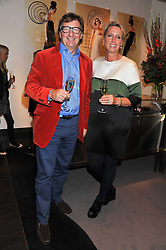 JOHN AYTON and ANNOUSHKA DUCAS at a private view of jewellery and photographs by Rosie Emerson and Annoushka Ducas entitled Alchemy in association with Ruinart Champagne held at Annoushka, 41 Cadogan gardens, London SW3 on 15th September 2011.