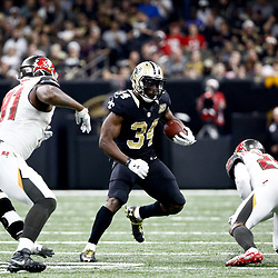 Dec 24, 2016; New Orleans, LA, USA; New Orleans Saints running back Tim Hightower (34) runs from Tampa Bay Buccaneers defensive end Robert Ayers (91) and cornerback Vernon Hargreaves (28) during the second quarter of a game at the Mercedes-Benz Superdome. Mandatory Credit: Derick E. Hingle-USA TODAY Sports
