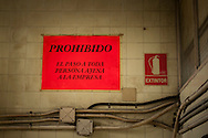 A poster on the wall, where can be read 'forbidden passage to any person outside the company'. Donostia (Basque Country). May 1, 2015.  A group of people occupies the former factory of Firestone, which was abandoned long ago, to promote alternative models of work, relationship and lifestyle initiatives. They will call it 'Eraldia' (Ocassion or opportunity in Basque language) (Gari Garaialde / BostokPhoto)