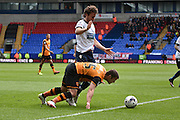 Hull City Midfielder,  Shaun Maloney  is tackled during the Sky Bet Championship match between Bolton Wanderers and Hull City at the Macron Stadium, Bolton, England on 30 April 2016. Photo by Mark Pollitt.