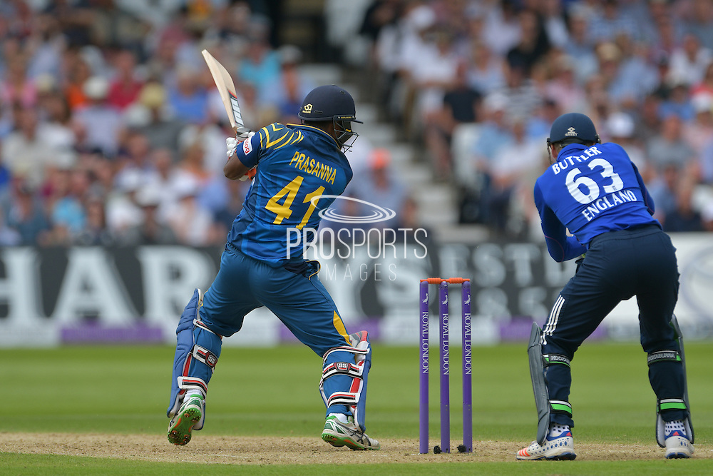 Seekkuge Prasanna of Sri Lanka cuts Adil Rashid of England (not shown) watched on by Jos Buttler of England during the Royal London ODI match between England and Sri Lanka at Trent Bridge, West Bridgford, United Kingdom on 21 June 2016. Photo by Simon Trafford.