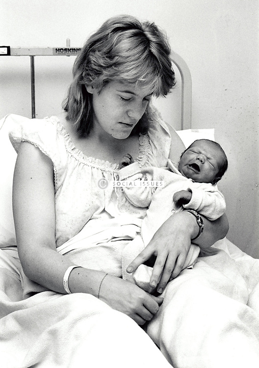 Newborn baby & mother, hospital, Queen's Medical Centre, Nottingham UK 1990